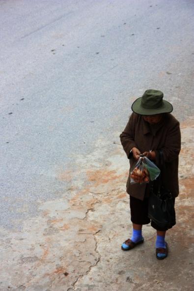 Vrouw in Pak Beng, het dorp waar we overnachten na de eerst dag op de slowboat.